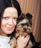 Young girl with her Yorkie puppy Stock Image