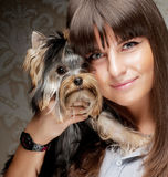 Young girl with her Yorkie puppy Stock Photos