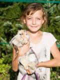 Young girl with het rabbit Stock Photo