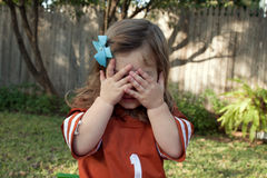 A young girl hiding Royalty Free Stock Image