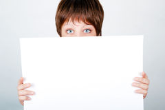 Young girl hiding a banner Royalty Free Stock Images