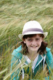 A young girl hiding in a corn field Royalty Free Stock Photography