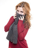 Young girl is hiding her face with gray shawl Royalty Free Stock Photos