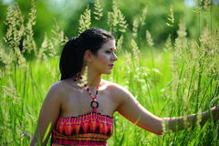 Young girl in high grass field Stock Photo