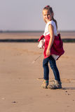 Young girl hiking on the beach Royalty Free Stock Photography