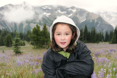 Young Girl hiking outdoors during early spring in the mountains Royalty Free Stock Photo