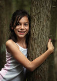 Young girl hiking in the woods. A Young girl hiking in the woods Stock Images