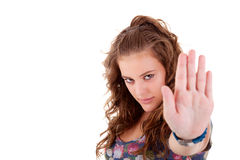 Young girl  with his hand raised in signal to stop Royalty Free Stock Images