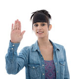 Young girl with his hand raised in signal to stop, on white Stock Image