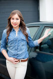 Young girl with his new car. Ready to drive Royalty Free Stock Image
