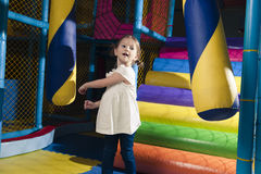 Young girl hitting foam object in play gym Royalty Free Stock Image