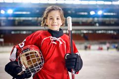 Young girl hockey players. In ice stock photography