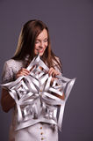 Young girl hold paper snowflake Stock Images