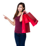 Young girl hold with shopping bag and finger point up Royalty Free Stock Photos