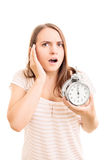 Young girl holding an alarm clock Royalty Free Stock Image