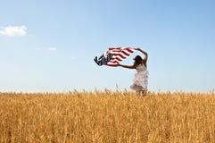 Young girl holding an American flag Stock Photos