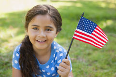 Young girl holding the American flag at park Stock Photo