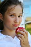 Young girl holding apple Royalty Free Stock Images