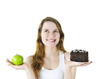 Young girl holding apple and cake Stock Images