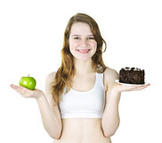 Young girl holding apple and cake Stock Photo