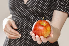 Young girl holding an apple. Healthy food Stock Photo