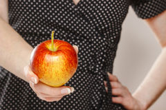 Young girl holding an apple Royalty Free Stock Images