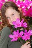 Young girl holding azaleas Royalty Free Stock Photo