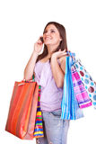 Young girl holding bags and cell phone Royalty Free Stock Image
