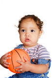 Young girl holding a ball. An african american toddler holding a ball Royalty Free Stock Photos
