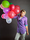 Young girl holding balloons Royalty Free Stock Photo