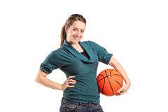Young girl holding a basketball royalty free stock images