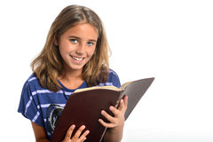 Young Girl Holding Bible. Portrait of young girl holding Bible isolated over white background Stock Images