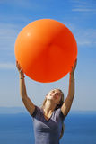 A girl holding big balloon Stock Images