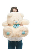 Young girl holding big teddy bear stock images
