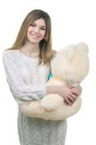 Young girl holding big teddy bear Royalty Free Stock Photo