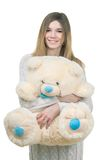 Young girl holding big teddy bear Stock Image