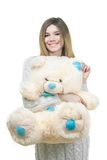 Young girl holding big teddy bear Royalty Free Stock Images