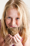Young girl holding birds nest Stock Photography