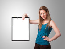 Young girl holding black folder with white sheet copy space Stock Image