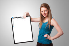 Young girl holding black folder with white sheet copy space Stock Images