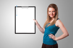 Young girl holding black folder with white sheet copy space Royalty Free Stock Photo