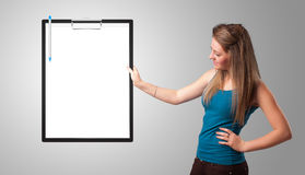 Young girl holding black folder with white sheet copy space Royalty Free Stock Image