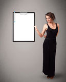 Young girl holding black folder with white sheet copy space Stock Photos