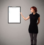 Young girl holding black folder with white sheet copy space Royalty Free Stock Photos