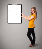 Young girl holding black folder with white sheet copy space Royalty Free Stock Photography