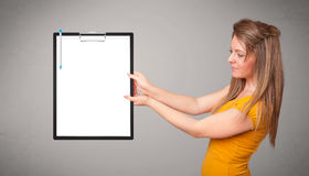 Young girl holding black folder with white sheet copy space Stock Photo