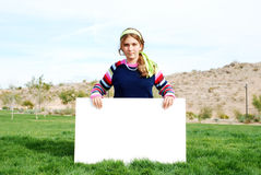 Young girl holding blank sign Stock Photos