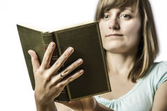 Young girl holding a book Stock Photos
