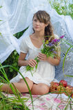 Young girl holding a bouquet of flowers Royalty Free Stock Photos