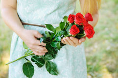 Young girl holding a bouquet of roses Royalty Free Stock Images